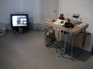 Jo David: Travelling Light, video/mixed media installation: hessian, iron, shell, rope, brick, paper, plastic
