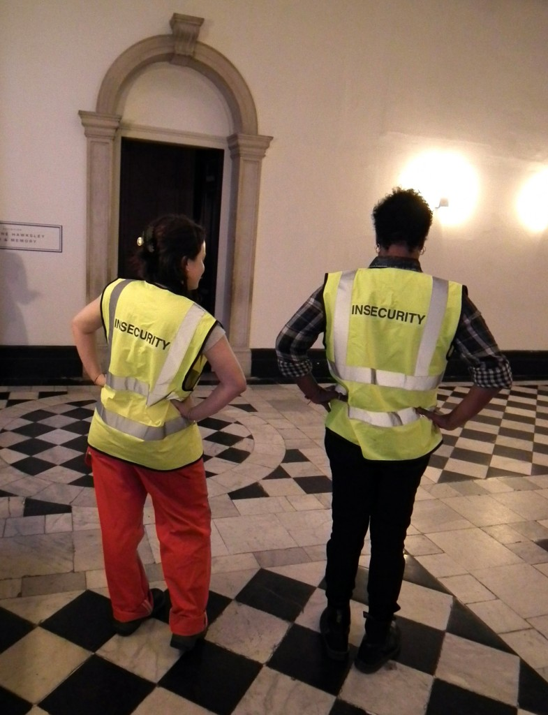 'Over Time project assistants at the museum: Sandra Louison and Stephanie Dickinson. 'Insecurity' jackets by Margareta Kern, 2014